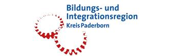 Logo der Bildungs- und Integrationsregion Kreis Paderborn. Auf dem Logo sind zwei Zahnräder. Die roten Zähne der Zahnräder greifen ineinander.